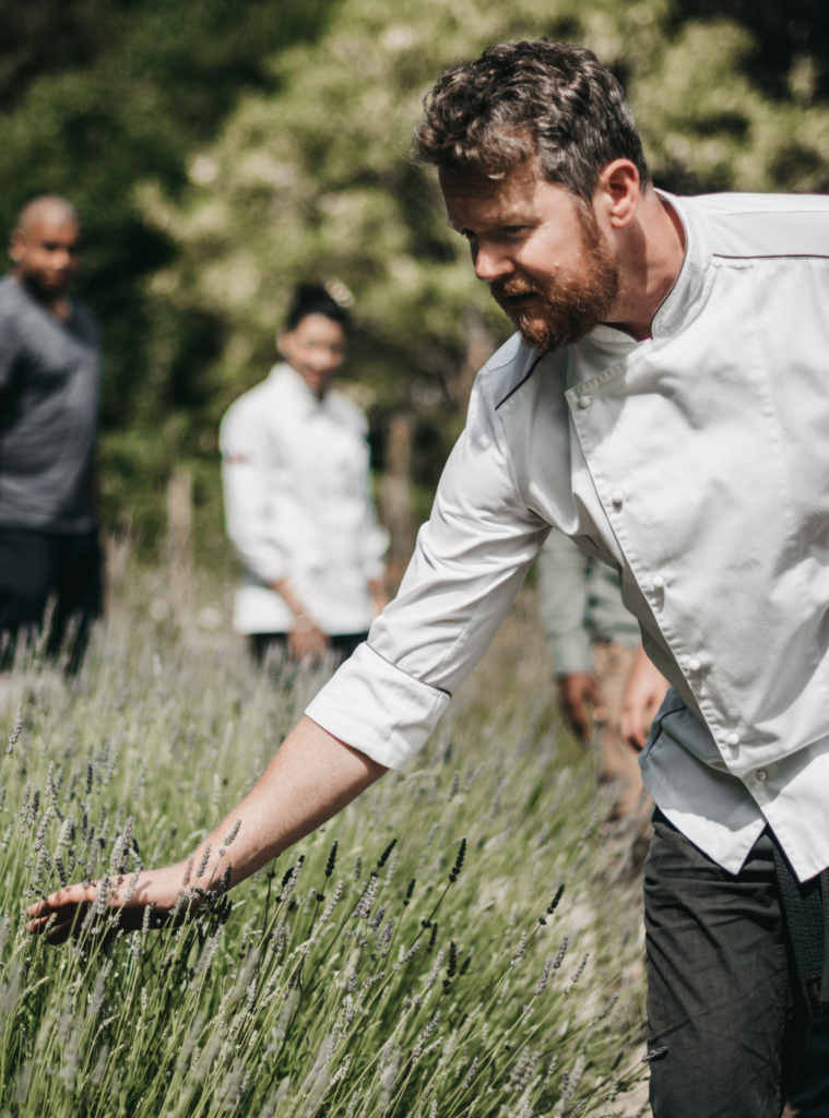 chef arthur dawson potts standing on top of a grass covered field